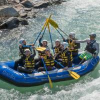 Wet and wild: The 'crew' of a rubber dinghy celebrates after passing through a tricky stretch of white water on the Arakawa River.   STEPHEN MANSFIELD