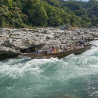 Experience at the helm: Longboats are made of wood and require great skill in navigating the faster stretches of the Arakawa River. | STEPHEN MANSFIELD