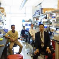 Team Nakamura: Yusuke Nakamura (right) runs a lab of 13 people at the University of Chicago.  | DANIEL MORALES