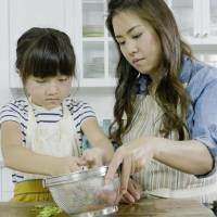 Family affair: Namiko Chen prepares food with her daughter. Chen's husband, Shen, films and edits the YouTube videos. | COURTESY OF NAMIKO CHEN