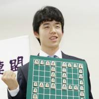 On game: Fourteen-year-old shogi player Sota Fujii celebrates his 29th win at the Ryuo Championship. | KYODO