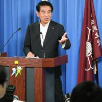 Money issues: At a June 29 news conference, Hakubun Shimomura, deputy secretary general of the LDP, tells reporters that the ¥2million he received in political donations from Kake Gakuen were from 11 individuals and therefore did not require being declared in official reports. | KYODO