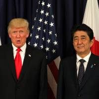Prime Minister Shinzo Abe could use U.S. President Donald Trump's focus on 'America First' as a historic opportunity to pursue a proactive Asian foreign policy.   REUTERS