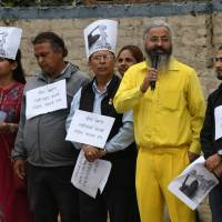 Nepali human rights activists gather outside the Chinese Embassy in Kathmandu on July 11 to protest tensions between India and China. Indian and Chinese troops are facing off on a section of land high in the Himalayas where Tibet, India and Bhutan meet. | AFP-JIJI