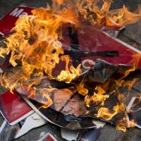 Hindu right-wing activists burn portraits of Chinese President Xi Jinping during a protest in New Delhi on July 4  as tensions rise along the Sino-Indian border. | AP