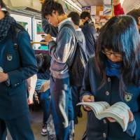 All change: Students hit the books on the school commute. Changes are afoot for both the Center Test for entrance to public universities and procedures governing entry to private colleges. | ISTOCK
