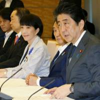 Prime Minister Shinzo Abe speaks at a meeting July 14 in Tokyo on measures to address the impact of the TPP and other free trade deals on domestic farmers. | KYODO