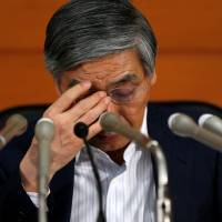Bank of Japan Gov. Haruhiko Kuroda, shown at a July 20 news conference at BOJ headquarters in Tokyo,  has been waging an uphill battle against deflation  since April 2013. | REUTERS