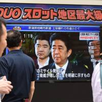 A television news broadcast shows Prime Minister Shinzo Abe addressing the media in Tokyo on Tuesday in response to North Korea's successful launch of a ballistic missile that day.   AFP-JIJI
