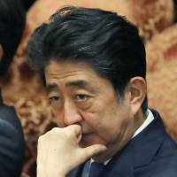 Prime Minister Shinzo Abe, appearing July 24 in the Diet, has seen his Cabinet's popularity ratings plummet in the wake of several scandals, but the troubled Democratic Party has been unable to capitalize on the administration's woes. | AFP-JIJI