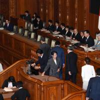 Upper House members cast their votes on the contentious amendment to the law against organized crimes in the early morning of June 15. | KYODO