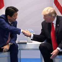 Prime Minister Shinzo Abe and U.S. President Donald Trump, shown at last week's Group of 20 summit, took little time to build a personal rapport. | AFP-JIJI