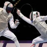 Russia's Dmitry Zherebchenko (left) wins the duel against Toshiya Saito during the men's individual foil final at the World Fencing Championships on Sunday in Leipzig, Germany. | AP