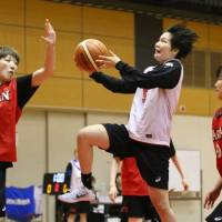 Japan guard Manami Fujioka (center), seen in a file photo from a team training session in April, had 18 points and 10 assists on Tuesday against Australia in a FIBA Women's Asia Cup match. | KAZ NAGATSUKA