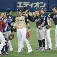Pacific League players celebrate their victory over the Central League in Game 1 of the NPB All-Star Series on Friday night at Nagoya Dome. The PL defeated the CL 6-2. | KYODO