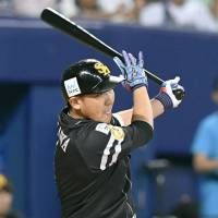 The Hawks' Seiichi Uchikawa strokes a two-out single in the eighth inning for the Pacific League. Uchikawa had a pair of hits and was name MVP for Game 1 of the NPB All-Star Series. | KYODO