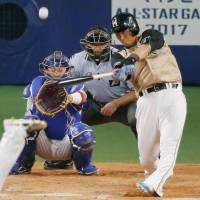The Fighters' Sho Nakata slugs a solo homer in the ninth inning. | KYODO