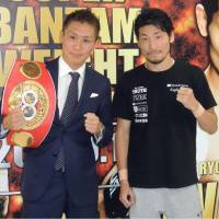 IBF super bantamweight champion Yukinori Oguni (left) and challenger Ryosuke Iwasa attend a news conference to promote their September title fight. | KYODO
