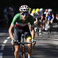 Yates captures white jersey his twin won before as Aru takes fifth stage
