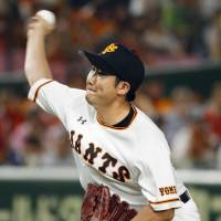 Giants hurler Tomoyuki Sugano fires a pitch during Tuesday night's game against the Swallows at Tokyo Dome. Sugano worked seven scoreless innings in Yomiuri's 2-0 win over Tokyo Yakult. | KYODO