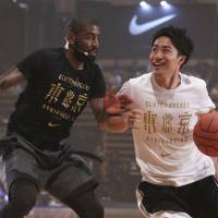 Cleveland Cavaliers superstar Kyrie Irving takes on a young Japanese player during Friday's Clutch Bucket event in Tokyo. | KAZ NAGATSUKA