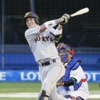 The Giants' Seiji Kobayashi hits a solo homer in the third inning for the Central League. | KYODO