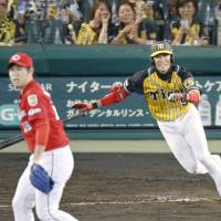 Tigers hold off league-leading Carp