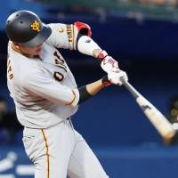 The Giants' Hayato Sakamoto hits his 10th home run of the season in the fourth inning on Friday against the BayStars at Yokohama Stadium. The game ended in a 3-3 tie. | KYODO