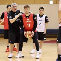 New head coach Julio Lamas instructs Japan men's national team players during Friday's practice at Tokyo's National Training Center. | KAZ NAGATSUKA