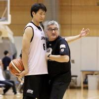 Japan coach Julio Lamas works with guard Makoto Hiejima to illustrate a point during Friday's practice at the National Training Center in Tokyo. | KAZ NAGATSUKA