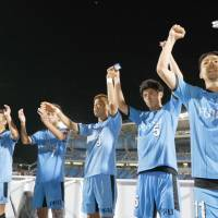 Frontale players salute their fans after beating Reds 4-1 in Kawasaki on Wednesday night. | KYODO