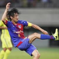 FC Tokyo's Yojiro Takahagi takes a shot during his team's match against Sanfrecce Hiroshima in the J. League Cup on Wednesday. Tokyo won 1-0. | KYODO