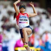 Chiaki Takada competes in the women's long jump T11 category at the World Para Athletics Championships in London on Thursday. Takada rewrote her own national record with a jump of 4.49 meters. | KYODO