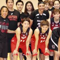 South Carolina women's basketball team head coach Dawn Staley (second from left) poses for a photo with her players and Japanese players after their scrimmage on Tuesday in Tokyo. | KAZ NAGATSUKA