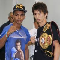 WBA light flyweight champion Ryoichi Taguchi (right) and challenger Robert Barrera attend a signing ceremony on Saturday, a day before their title bout at Ota City General Gymnasium. | KAZ NAGATSUKA