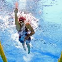 Ledecky dominates en route to third gold medal at worlds