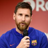 Barcelona star Lionel Messi speaks to reporters during a Thursday news conference in Tokyo. | AFP-JIJI