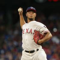AL East-leading Red Sox rough up Darvish