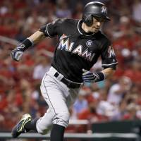 Stanton homers twice to lead Marlins by Cards
