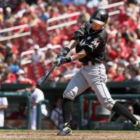 Miami's Ichiro Suzuki singles against St. Louis in the eighth inning Thursday to become the MLB's all-time leader in hits by a foreign-born player. | AP