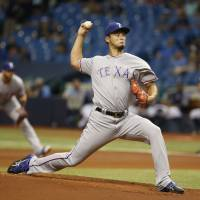 Darvish fans 12 in no-decision
