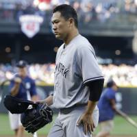 Mariners rough up Tanaka, top Yankees in 10