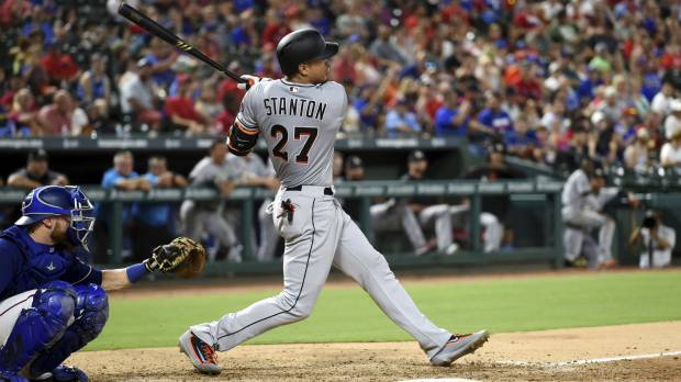 Stanton stays hot, powers Marlins past Rangers
