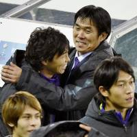 Hajime Moriyasu, pictured hugging striker Hisato Sato during the 2015 Club World Cup, resigned as manager of Sanfrecce Hiroshima on Tuesday. | KYODO