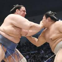 Aoiyama (left) competes against Takanoiwa at the Nagoya Grand Sumo Tournament on Friday. | KYODO