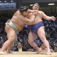 Ozeki Takayasu forces Shodai out of the raised ring on Saturday during their Nagoya Grand Sumo Tournament match at Aichi Prefectural Gymnasium. | KYODO