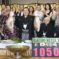 Hakuho celebrates after winning the Nagoya Grand Sumo Tournament on July 23.  | KYODO
