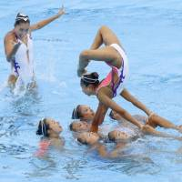 Japan's synchronized swimming team performs at the world swimming championships on Saturday in Budapest. | KYODO