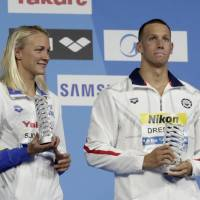 Dressel matches Phelps with seventh gold of world championships