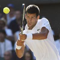 Djokovic spars with umpire, beats Gulbis to reach fourth round of Wimbledon